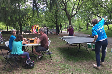 People play ping pong in an Ottawa park