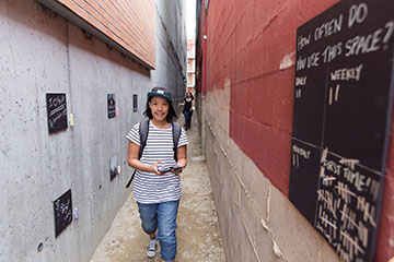 A girl walks down an Edmonton alley
