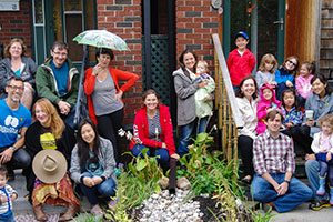 Danforth East Village residents gathered around the rain garden.